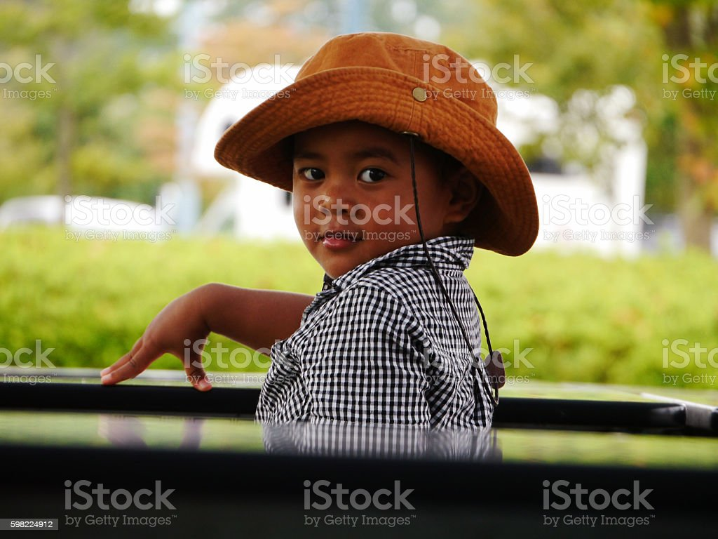 The boy sitting in nature foto royalty-free