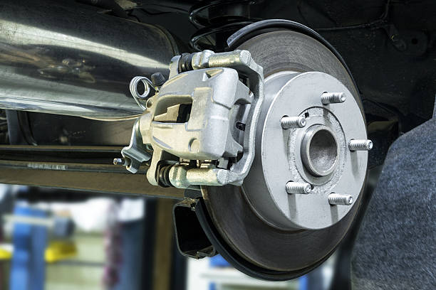 the brake system of a vehicle - brake service stock photos and pictures