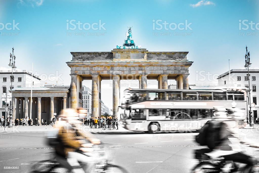 The Brandenburg Gate in the middle of burly city-life stock photo