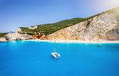 The breathtaking Porto Katsiki beach on the island of Lefkada, Greece, with vibrant blue sea and fine pebble beach under the steep chalk cliffs
