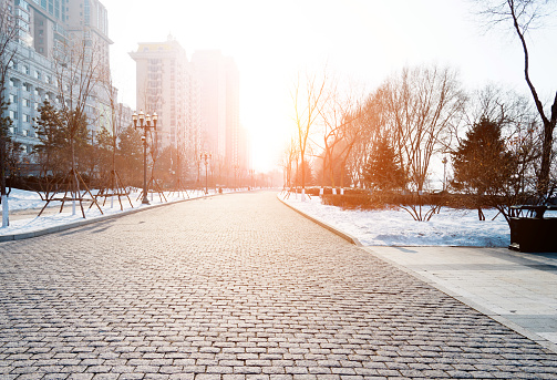 istock The brick road is covering with snow 1008994016