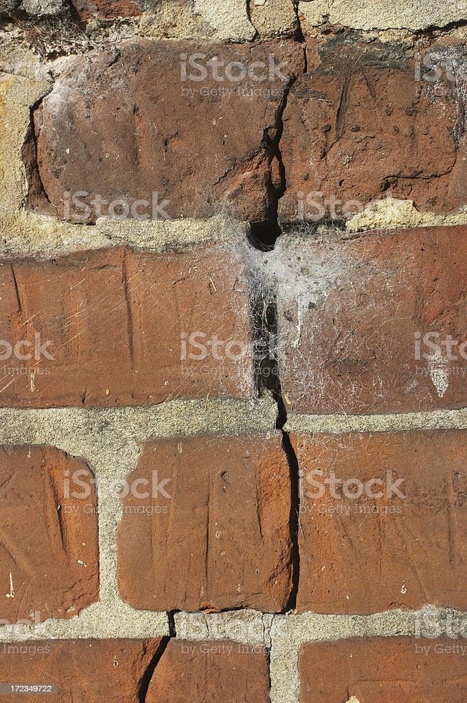 Unsound structure split red bricks in wall royalty-free stock photo