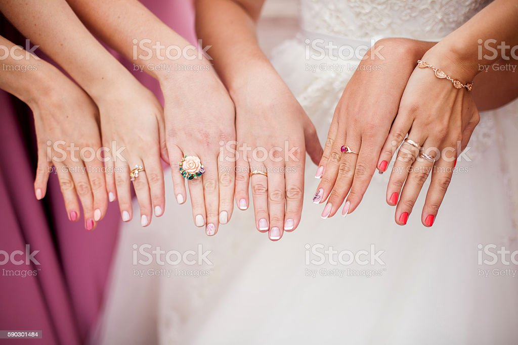 The bride and bridesmaids are showing their hands with rings royaltyfri bildbanksbilder