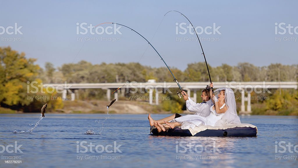 The bride and groom are fishing royalty-free stock photo