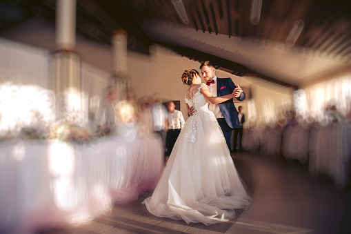 The bride and groom dance during the wedding ceremony