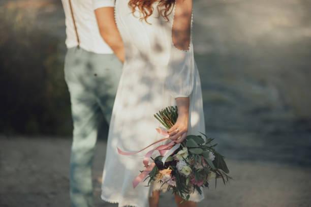 the bride and groom in nature. rustic wedding - brautstrauß aus holz stock-fotos und bilder