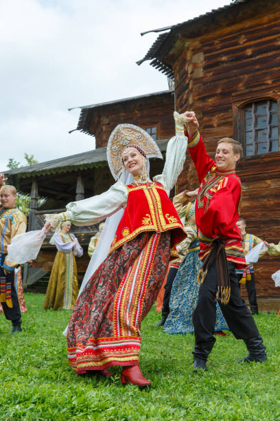 the bride and groom in traditional russian costumes - traditional ceremony stock pictures, royalty-free photos & images