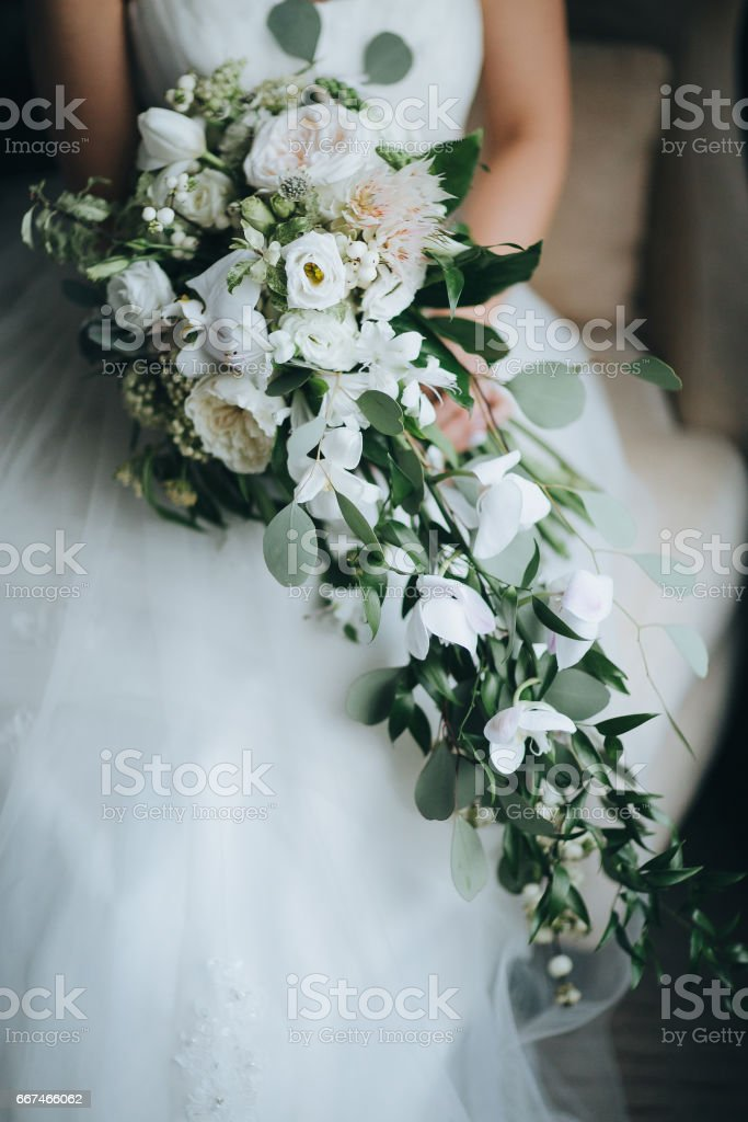 The bride hold wedding bouquet in hands stock photo