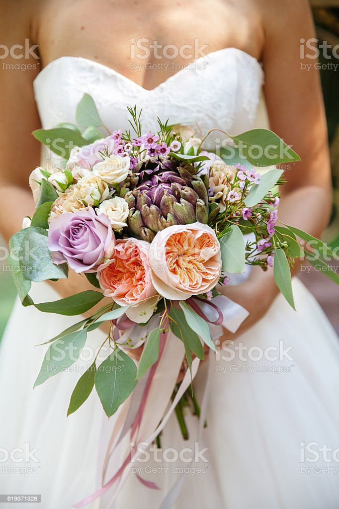 The bride holds beautiful wedding bouquet stock photo