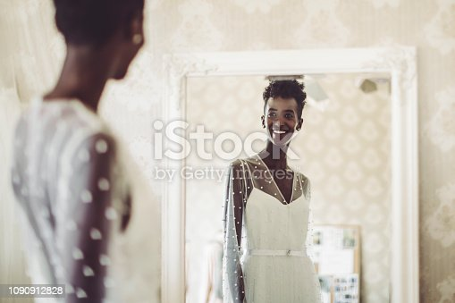 The bride is trying out her wedding dress
