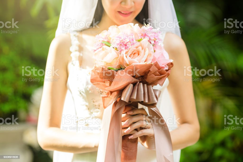 The bride smell her flower. stock photo