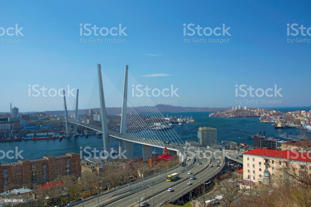 the bridge across the Bay, in the port city. sunny day and flourishing greenery stock photo