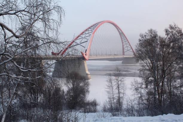 The bridge across the Ob river in Novosibirsk in the winter. stock photo