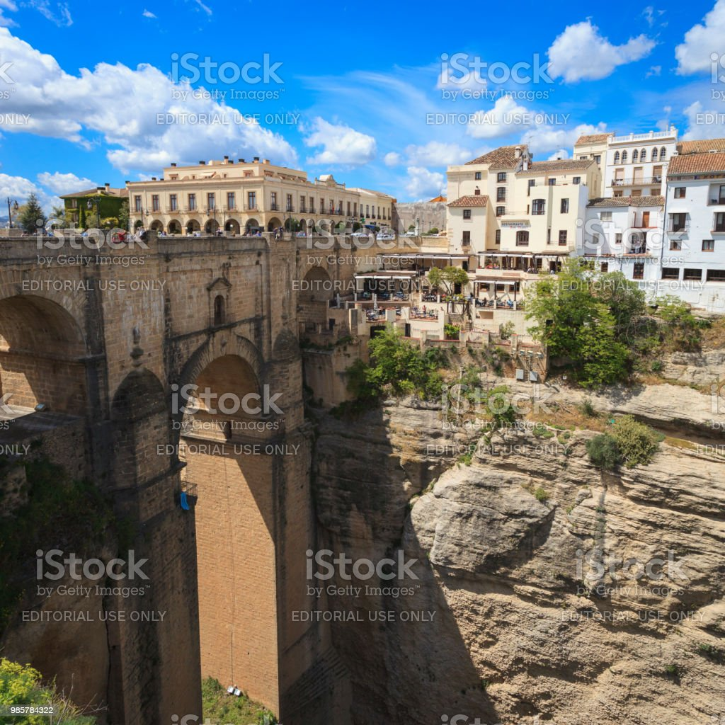 The bridge and gorge in Ronda, Andalusia, Spain. stock photo