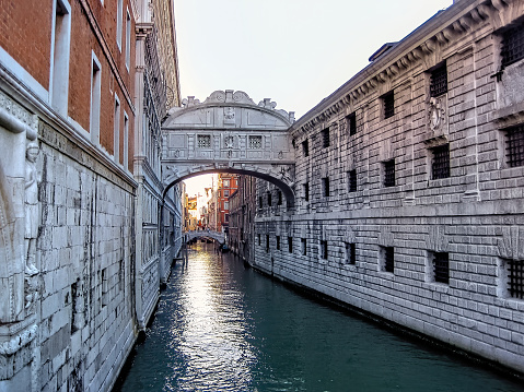 The Bridge of Sighs, Ponte dei Sospiri, in the evening sun with reflecting water, Venice, Italy