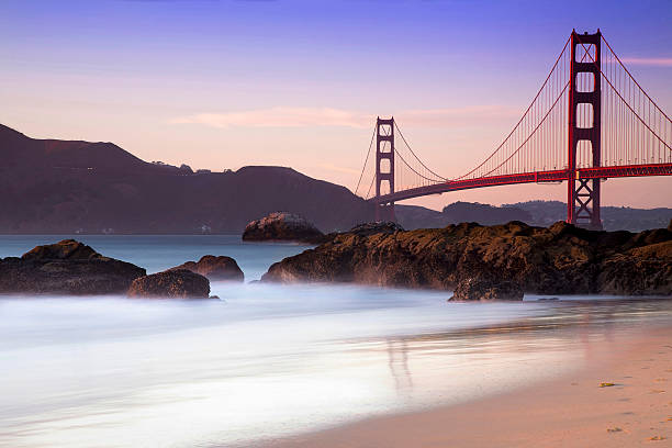 The Bridge Golden Gate from Baker beach in the sunset golden gate bridge stock pictures, royalty-free photos & images