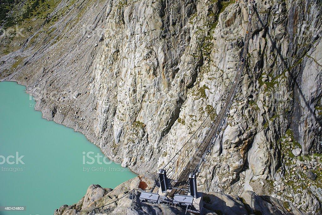 The bridge spans the lake, Triftsee, Switzerland stock photo