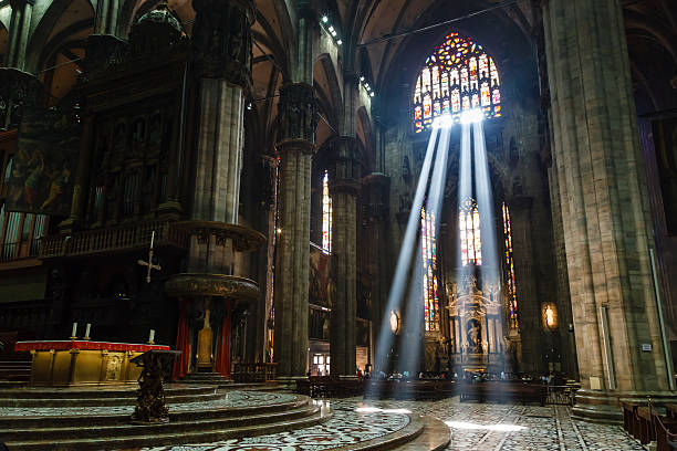 the bright beam of light inside milan cathedral, italy - gothic style stock pictures, royalty-free photos & images