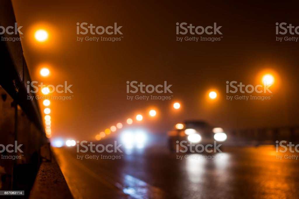 The bright lights of the city at night, the car goes over the road bridge stock photo