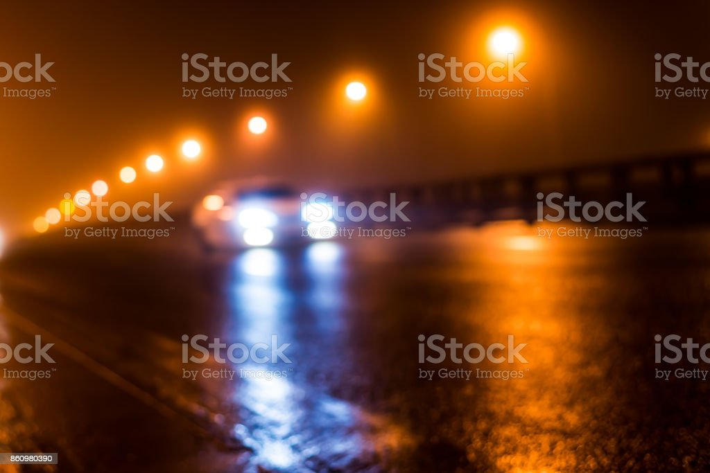 The bright lights of the city at night, the car racing on the road bridge stock photo