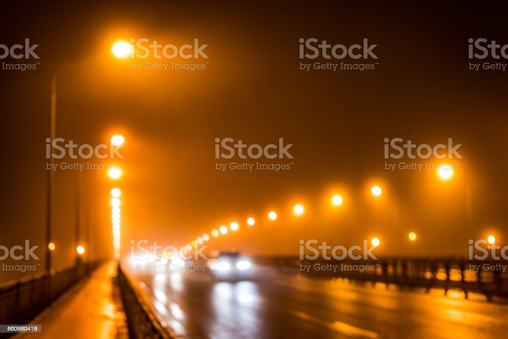 The bright lights of the city at night, the cars goes over the road bridge stock photo