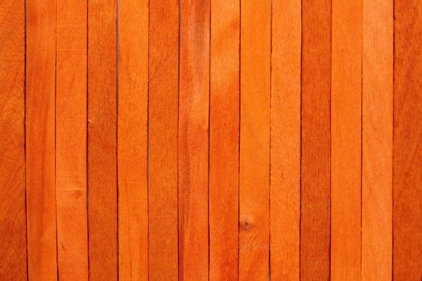 The bright orange wooden background. Colorful background. stock photo