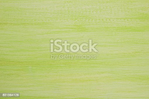 istock The bright painted green and white wooden textured background. 831564126
