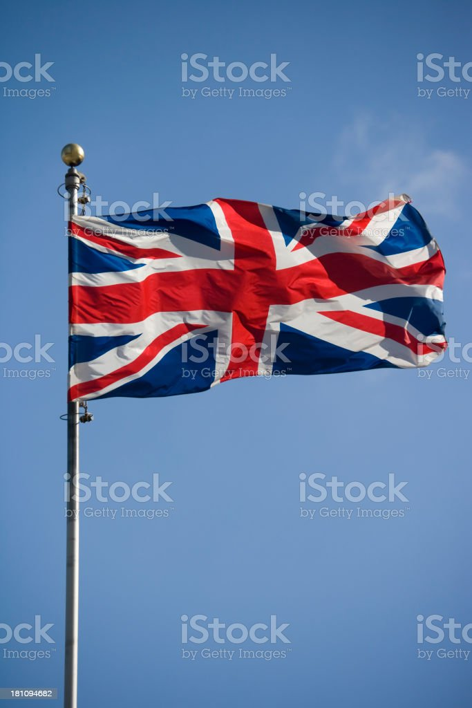 The British flag flying high on top of a flagpole stock photo