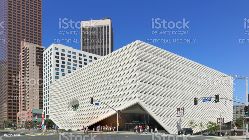 The Broad - Grand Avenue - Los Angeles Los Angeles, USA - July 22, 2018: Grand Avenue streetscape featuring Bunker hill skyscrapers and The Broad - an art museum in Downtown Los Angeles (opened 2015). The three-story structure is named for philanthropist Eli Broad and features 50,000 square feet of exhibition space for its extensive collection of contemporary art. Architecture Stock Photo