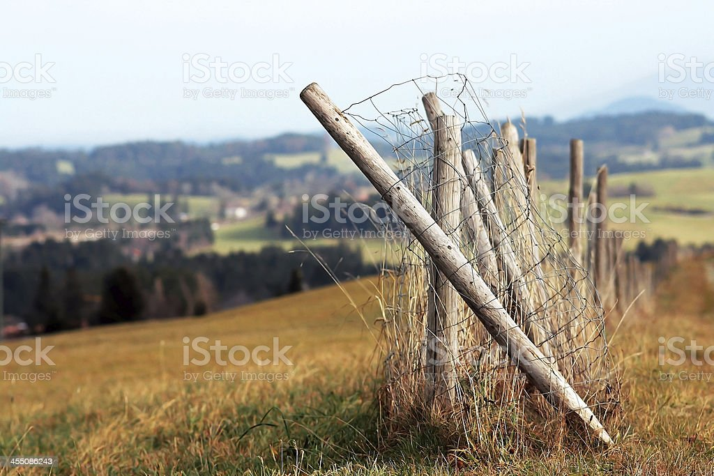 the broken fence stock photo