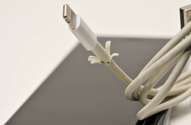 the broken iphone charger cable. - lightning стоковые фото и изображения