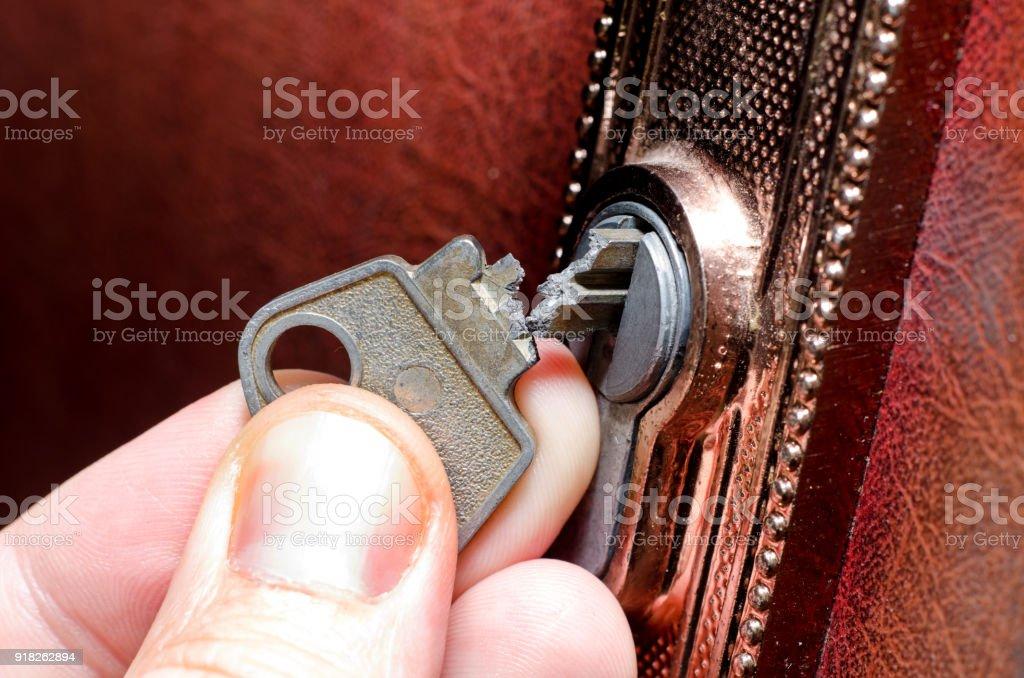 The broken key in the lock stock photo