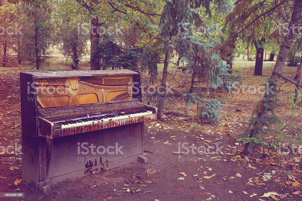 the broken piano stock photo