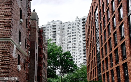 A trio of high rise residential apartment buildings are seen in this cityscape, an example of urban density in The Bronx, New York City, Northeastern USA.