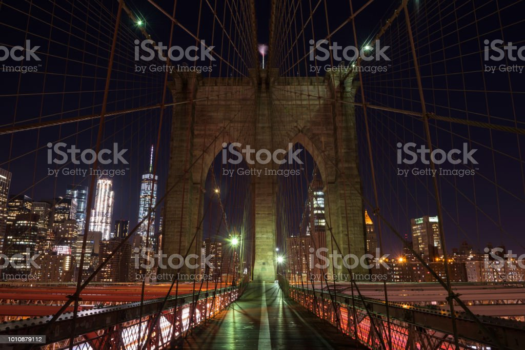 The Brooklyn bridge from a nice perspective by night stock photo
