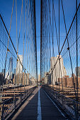 Manhattan, New York/United States - January 8, 2014: The distinctive Brooklyn Bridge on a very sunny winter's morning in Manhattan.