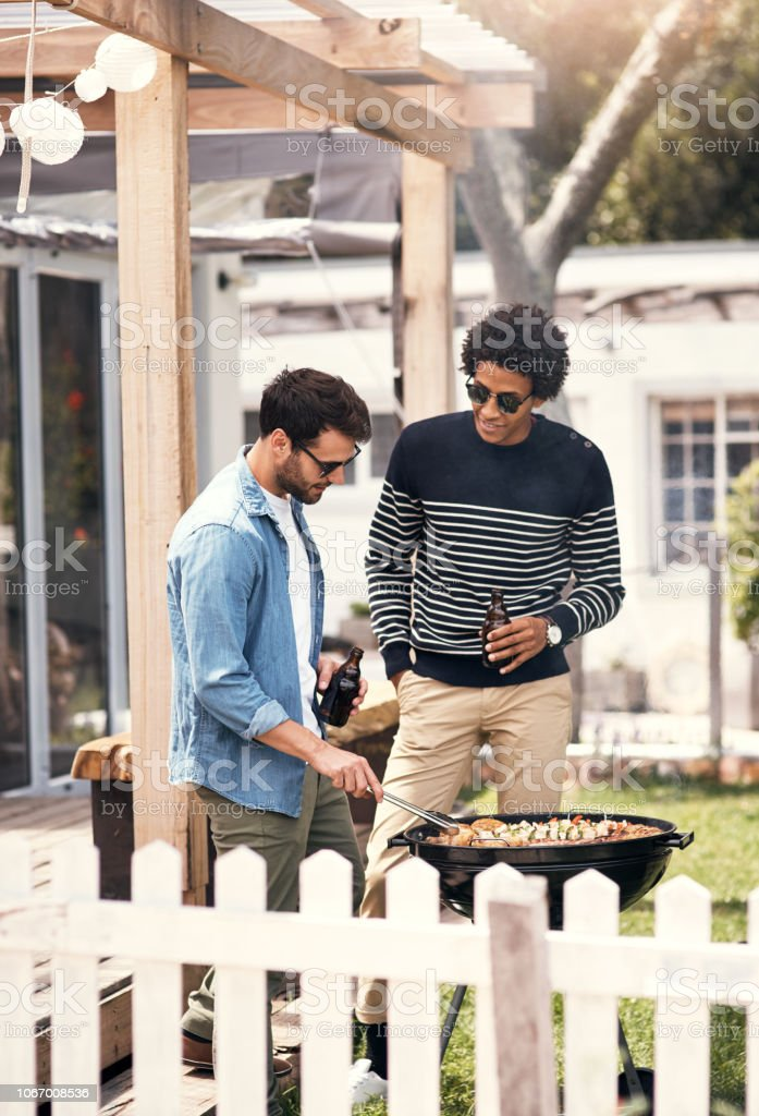The bros are manning the barbecue stock photo