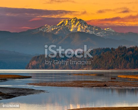 The Brothers, at 6842' above sea level, are a pair of prominent peaks in the Olympic Mountains of Washington State. This picture was taken at sunset from Annas Bay near the town of Union on Hood Canal.