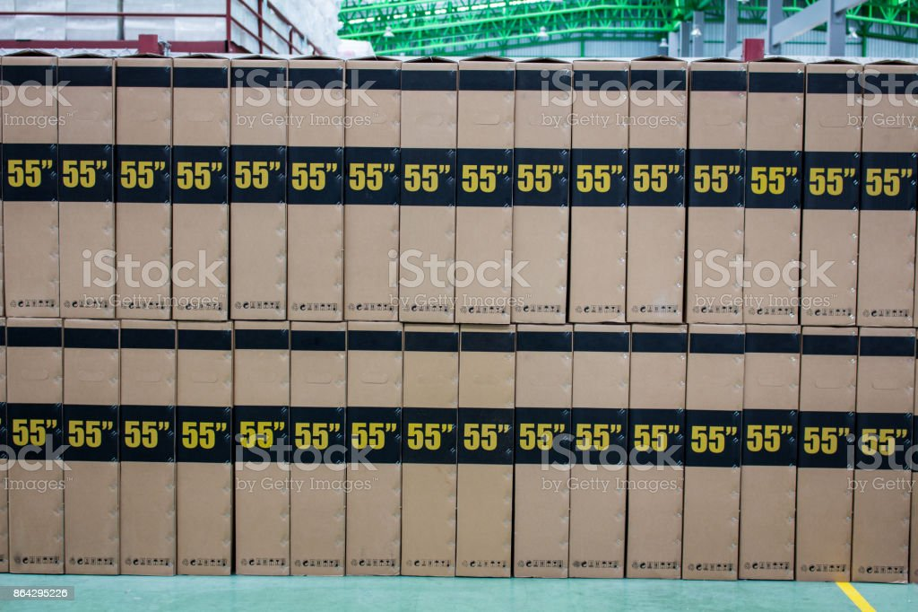 The brown boxes keep on floor in warehouse royalty-free stock photo