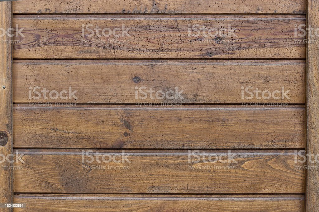 The brown wood texture with natural patterns royalty-free stock photo
