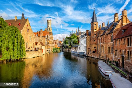 The Rozenhoedkaai canal, historical brick houses and the Belfry in Bruges medieval Old Town, Belgium, a UNESCO World Culture Heritage site
