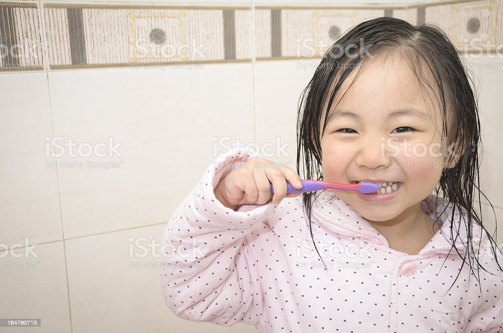 The brushing of small girl royalty-free stock photo