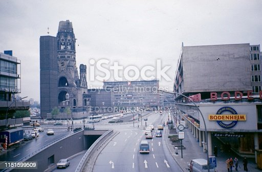 Berlin West, Germany, 1974. The Budapester Straße towards Zoo Station. On the left the Bikini Haus, on the right the Kaiser Wilhelm Gedächtniskirche. Furthermore: cars, pedestrians and advertising signs.
