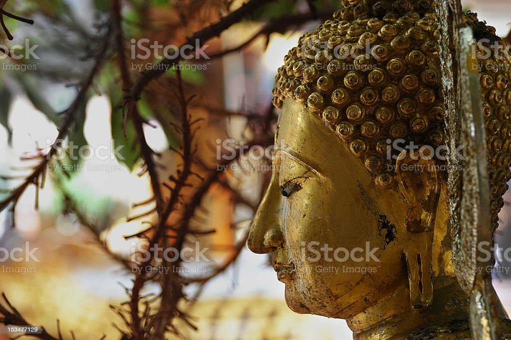 The Buddha's face has some tears in Thailand. stock photo