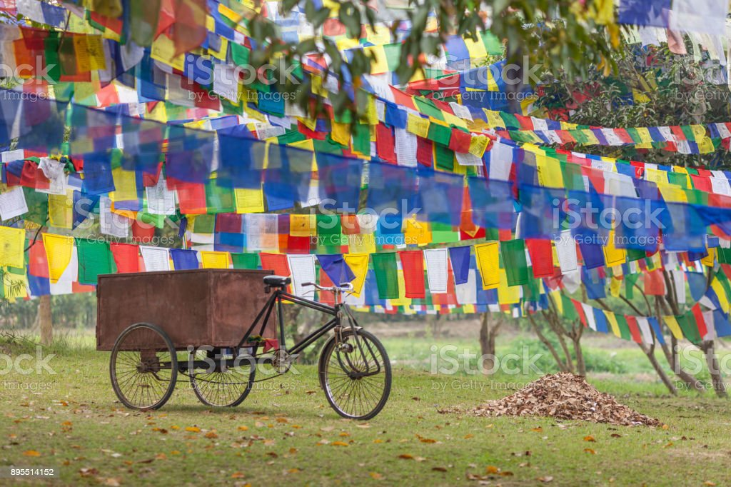 The buddhist old tricycle - the rickshaw using for cargo hauling. stock photo