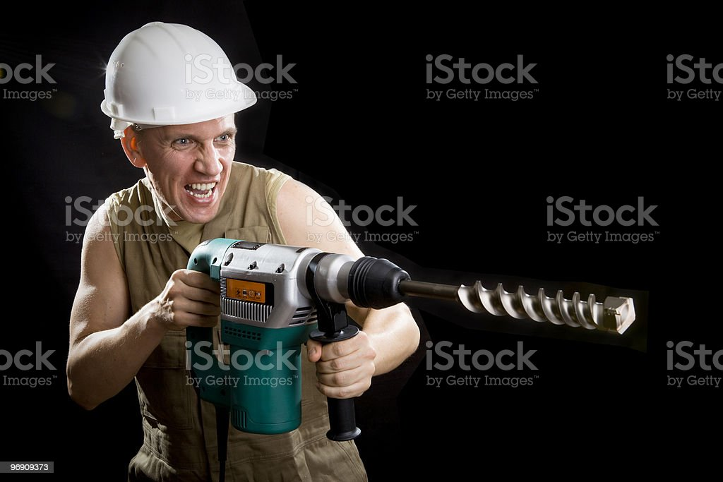 The builder in a protective helmet royalty-free stock photo