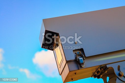 Security camera on blue sky background, camera cctv