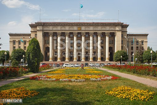 ALMATY, KAZAKHSTAN - JULY 27, 2017: The building of Kazakh-British University (former Central Committee of the Communist Party Kazakh SSR) in Almaty. Was built in 1951-1957 in stalin empire style.