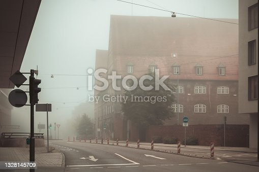 istock The building of the Police Headquarters (Polizeipräsidium) on a foggy morning on the Neuer street (Neuer strasse) in Ulm, Germany 1328145709