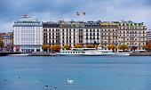 Geneva, Switzerland - November 12, 2017: Close-up of the buildings at Lake Geneva riverbank and cruise ship pier, Geneva, Switzerland.